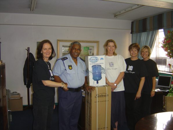 Glass Artists hand over gift to police station