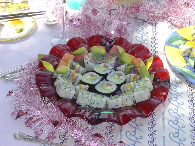 Delicious sushi in hand made platters