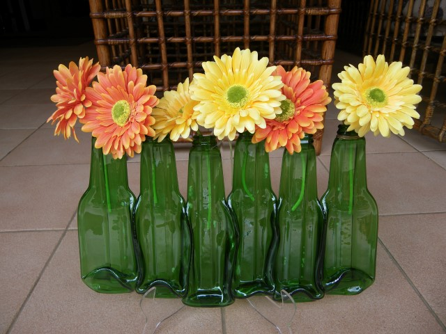 So many bottles hanging on the wall .... recycled glass bottle vases